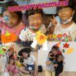 ハロウィンの仮装をする親子たち